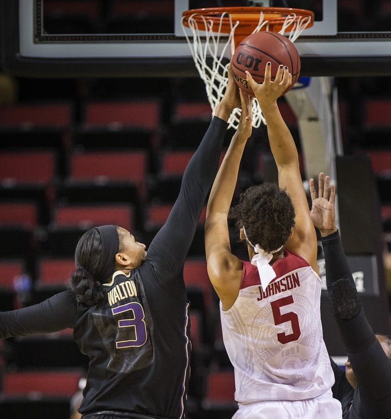 Talia Walton gets a clean block on the shot by Stanford's Kaylee Johnson in the first quarter.  T(Dean Rutz / The Seattle Times)