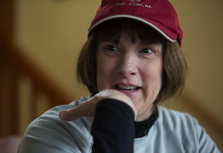 Lynne Long, publicity chair for Friends of Camp Kilworth, talks of the group's attempts to save the camp for the Cub, Boy and Girl Scouts.   (Ellen M. Banner / The Seattle Times)