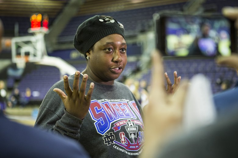 Chantel Osahor talks to reporters who have come to Montlake to feature the 7th-seeded Huskies who are moving on to their first-ever Final Four.