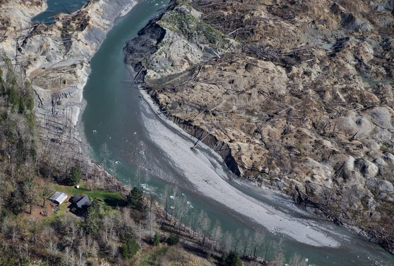 The North Fork Stillaguamish passes by the house of John Reed, one of the few surviving eyewitnesses to the slide.  (Lindsey Wasson/The Seattle Times)