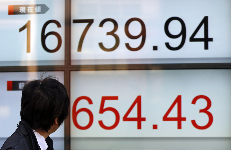 A man looks at the electronic stock indicator of a securities firm in Tokyo, Wednesday, March 2, 2016. Asian stocks jumped Wednesday after encouraging signs of strength in the U.S. economy sent shares higher on Wall Street. (AP Photo/Shizuo Kambayashi)