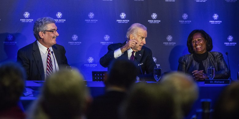 During the round-table discussion at the Fred Hutchinson Cancer Research Center, Biden talks with Angelique Richard, chief nurse executive of the clinical operations for the Cancer Care Alliance. At left is Dr. Gary Gilliland, president and director of the Fred Hutchinson Cancer Research Center.  (Steve Ringman/The Seattle Times)