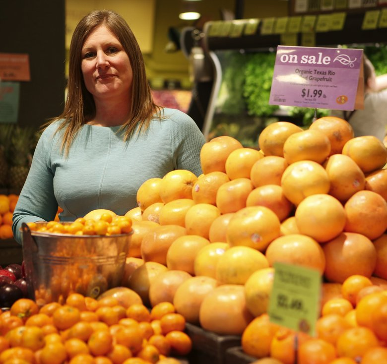 """PCC Natural Markets' Cate Hardy says the arrangement """"allows us to bring PCC to nearly all households"""" in the Seattle area. (Ken Lambert/The Seattle Times)"""