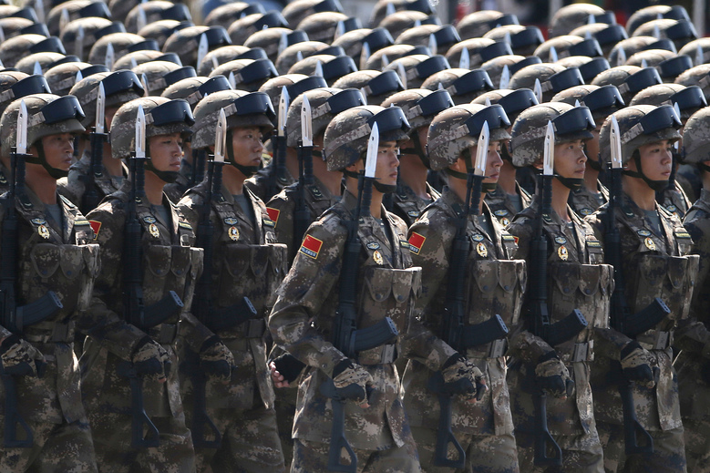 In this Thursday, Sept. 3, 2015 file photo, Chinese soldiers take part in a parade commemorating the 70th anniversary of Japan's surrender during World War II in front of Tiananmen Gate in Beijing. China said Friday, March 4, 2016, it will boost military spending by about 7 to 8 percent this year, the smallest increase in six years, reflecting slowing economic growth and a drawdown of 300,000 troops as Beijing seeks to build a more streamlined, modern military. (AP Photo/Ng Han Guan, File)