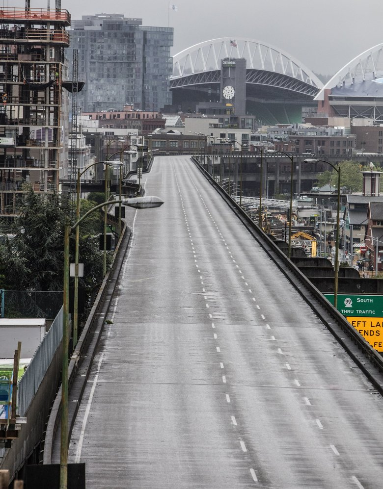 The Alaskan Way Viaduct is empty on Friday morning, as its two-week closure begins in order for Bertha to pass under it at Yesler Way.   (Steve Ringman / The Seattle Times)