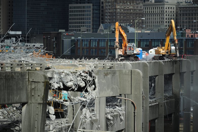 Machines chisel away at the southern end of the Alaskan Way Viaduct on Oct. 23, 2011. Closure of the elevated roadway brought gridlock to other Seattle routes at times. (John Lok/The Seattle Times)