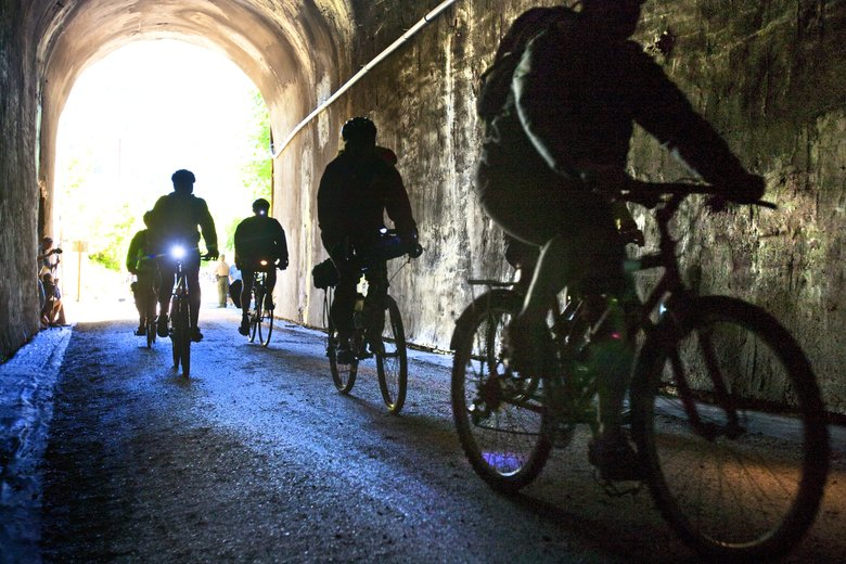 The Snoqualmie Tunnel, the longest nonmotorized mountain tunnel in the country, connects the John Wayne Pioneer Trail-Iron Horse State Park trail across the Cascade spine through cedar groves and over crystal streams. The tunnel is dark and damp even on a hot summer day.  (Mike Siegel/The Seattle Times)