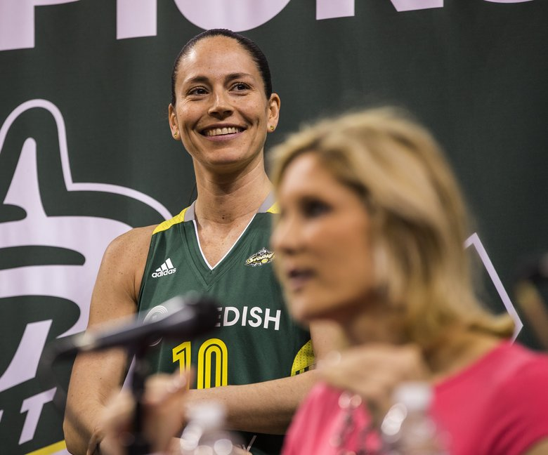 Sue Bird, behind coach Jenny Boucek on Thursday at KeyArena, signed a multiyear contract with the Storm in the offseason. (Dean Rutz/The Seattle Times)