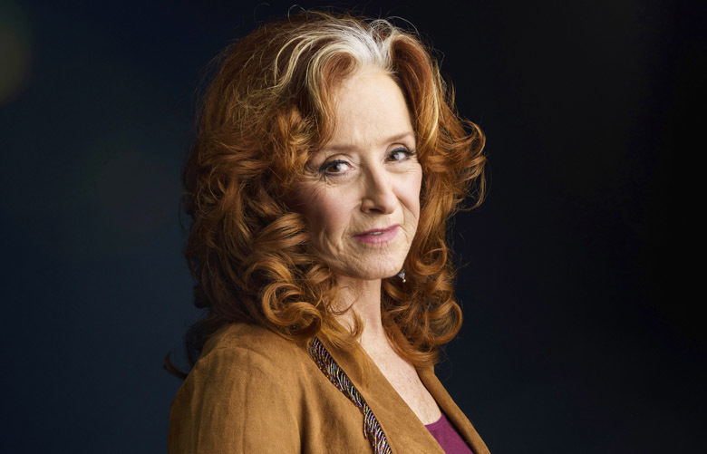 "In this March 7, 2016 photo, singer Bonnie Raitt poses for a portrait in New York to promote her new album, Dig In Deep."" (Photo by Drew Gurian/Invision/AP) NYET257"