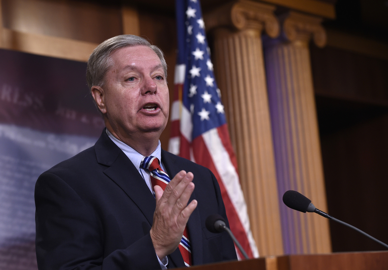 """FILE — In this Jan. 21, 2016 file photo, Sen. Lindsey Graham, R-S.C., a former Republican presidential candidate, answers questions about his opinions on the presidential candidates, during a news conference on Capitol Hill in Washington. On Sunday, April 3, 2016, Graham told reporters in Cairo, Egypt, that Republican candidate Donald Trump's campaign does not mean that the U.S. has """"fundamentally changed in terms of the way we view the world,"""" and even if he wins, the congress will be around doing its job. (AP Photo/Susan Walsh, File)"""