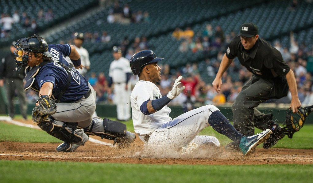 Ketel Marte beats the throw home to Tampa catcher Hank Conger in the 3rd inning, scoring off the sacrifice fly by Nelson Cruz. (Dean Rutz / The Seattle Times)
