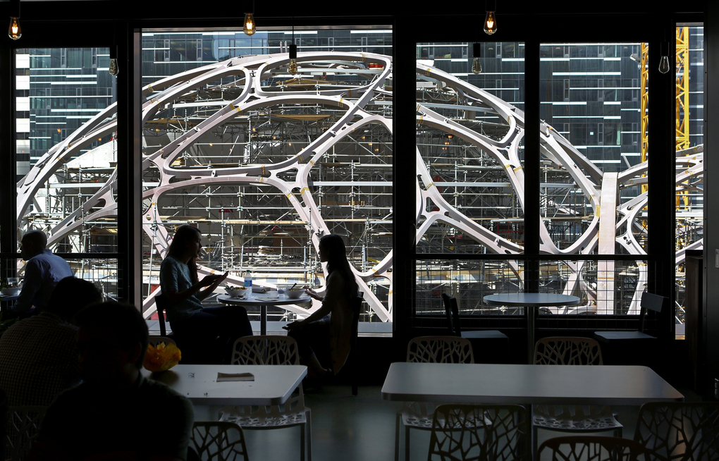 "Visitors to Amazon's cafeteria in the Doppler building get a bird's-eye view of the ""spheres"" building going up next door. (Ken Lambert/The Seattle Times)"