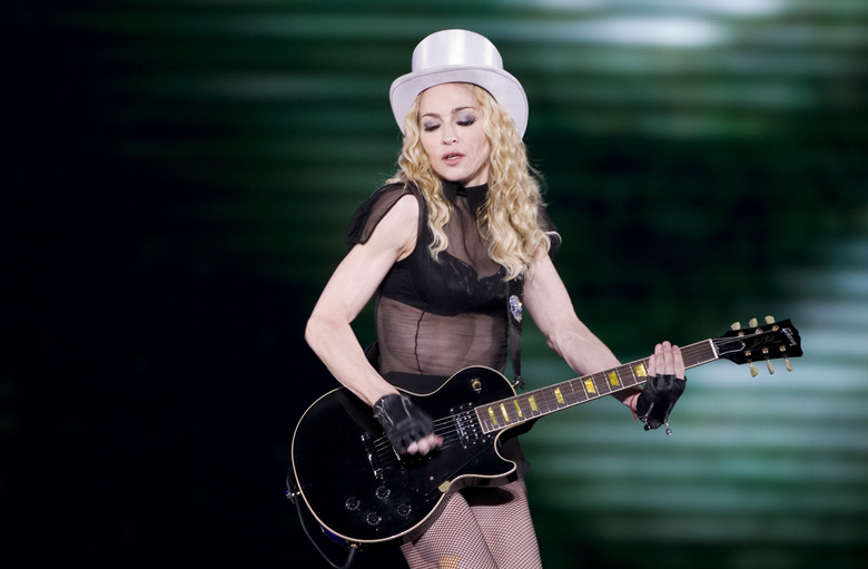 FILE – In this Nov. 29, 2008 file photo,  Madonna, center, performs in Mexico City. The Material Girl will pay tribute to The Purple One with a live performance at the Billboard Music Awards this month. Billboard and Dick Clark productions told The Associated Press on Wednesday, May 11, 2016 that Madonna will honor Prince at the May 22 show. Specific details about the performance weren't revealed. (AP Photo/Eduardo Verdugo)
