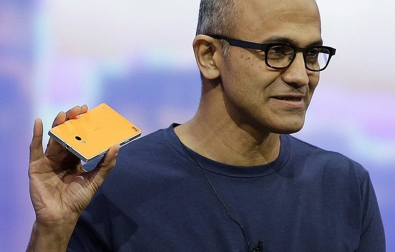 Microsoft CEO Satya Nadella holds up the Nokia Lumia 930 phone that uses Windows 8.1 during the keynote address of the Build Conference Wednesday, April 2, 2014, in San Francisco. (Eric Risberg/AP)