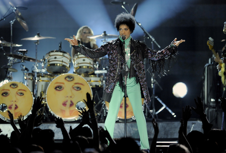 "FILE – In this May 19, 2013 file photo, Prince performs at the Billboard Music Awards at the MGM Grand Garden Arena, in Las Vegas. The executive producer of Sunday's Billboard Music Awards is defending the decision to have Madonna pay homage to Prince, which has been met with some criticism online and sparked a Change.org petition. ""Listen, I think everybody is entitled to their opinion and everyone can have their own opinion, but I will say that we are honored and could not be more excited for Madonna to be on the show and to pay tribute to someone that was her friend and her peer and her colleague,"" Mark Bracco said in an interview with The Associated Press on Tuesday, May 17, 2016. ""I think it's going to be fantastic.""  (Photo by Chris Pizzello/Invision/AP, File)"