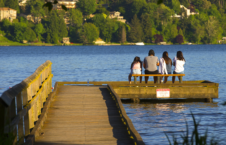 Hanging out in the early evening sunshine at the end of the walkway at Lyon Creek Waterfront Preserve on Lake Washington in Lake Forest Park.