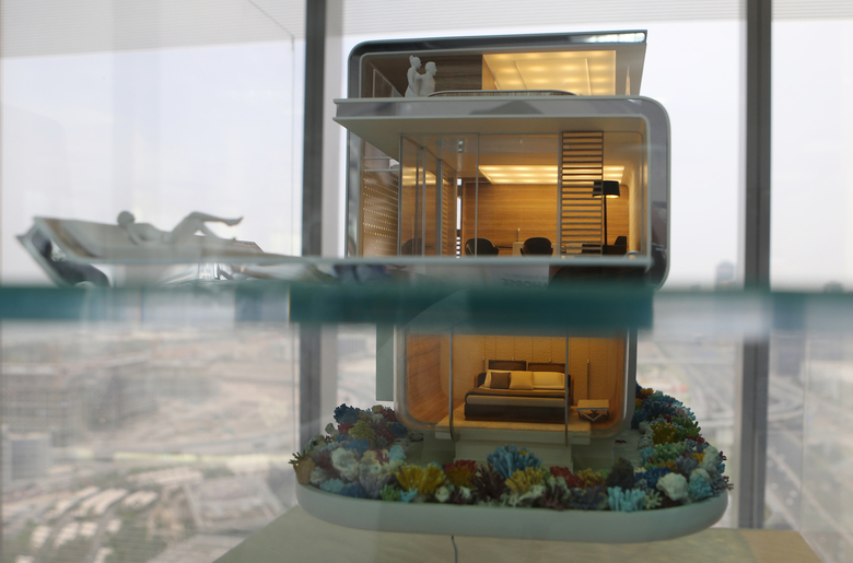 In this Monday, May 9, 2016 photo, the architectural model of the Floating Seahorse home is seen at the Kleindienst Group office in Dubai, United Arab Emirates. The Seahorses, part of an ambitious larger hotel development called The Heart of Europe, seeks to attract something that sounds even more grandiose. That's saving The World, as the long-stalled Earth-shaped island project off Dubai's coast is called. (AP Photo/Kamran Jebreili)