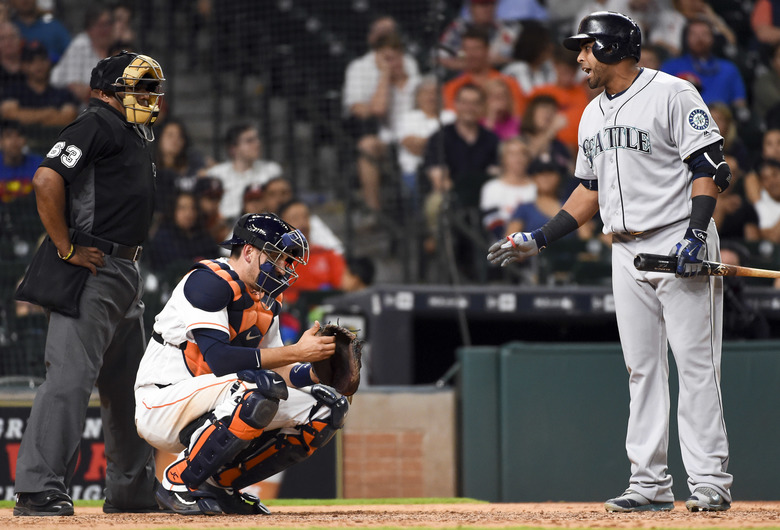 Nelson Cruz, right, argues a called strike with home plate umpire Laz Diaz in the eighth inning. (Eric Christian Smith/AP)