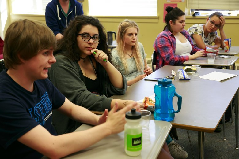 Seniors Peter Bryson, left, Ally Finn, Sami King, Adrianna Herrera and Camille Collins talk during a meeting of the West Seattle High School Gay-Straight Alliance. (Erika Schultz/The Seattle Times)