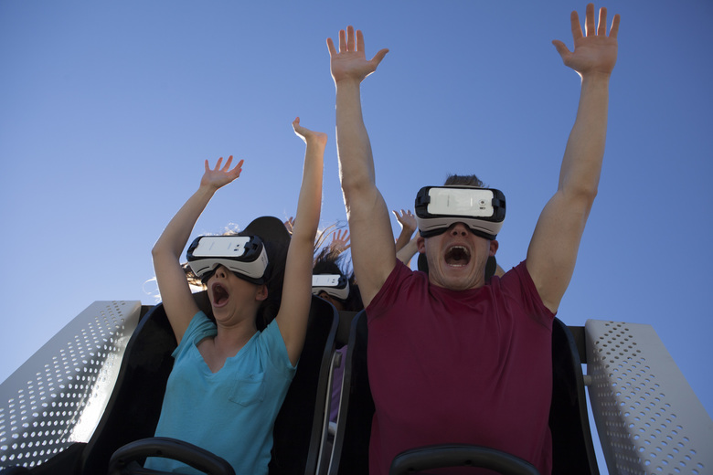 In this undated photo provided by Six Flags New England, visitors ride the new Superman The Ride Virtual Reality Coaster at the park in Agawam, Mass. (Six Flags New England via AP)