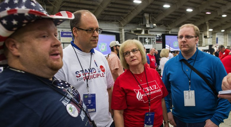 These King County Cruz delegates explain why they don't like Donald Trump. From left, Steven Wilson, and Matt, Lee and Alex Binz.  (Dean Rutz/The Seattle Times)