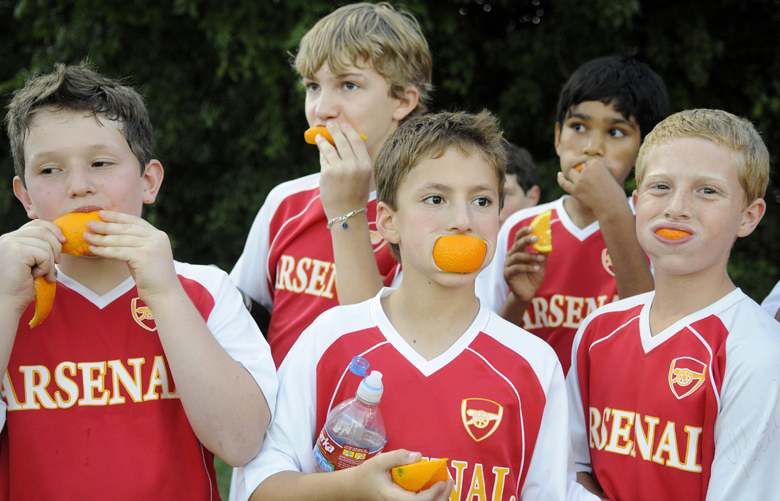 During halftime, fitth and sixth grade soccer players of team Arsenal, (front row, left to right) Ben Stromberg, Ryan Becker, Jake Hoffman, (back row, left to right) Cole Forson and Nikhil Rao eat a healthy snack before resuming their soccer game against team Synergy on September 27, 2010. Susan Sternblitz, mother of player Jordan Sternblitz, brings orange slices and encourages the kids to eat healthy. (Brendan Sullivan/TDallas Morning News/MCT) 1095905