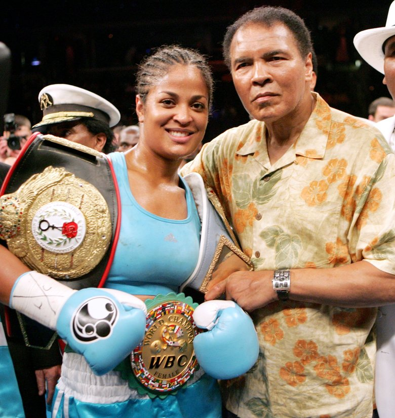 2005: Laila Ali, left, poses with her father, Muhammad Ali, after her win against Erin Toughill,  June 11, 2005,at the MCI Center in Washington, D.C.  (AP Photo/Pablo Martinez Monsivais)
