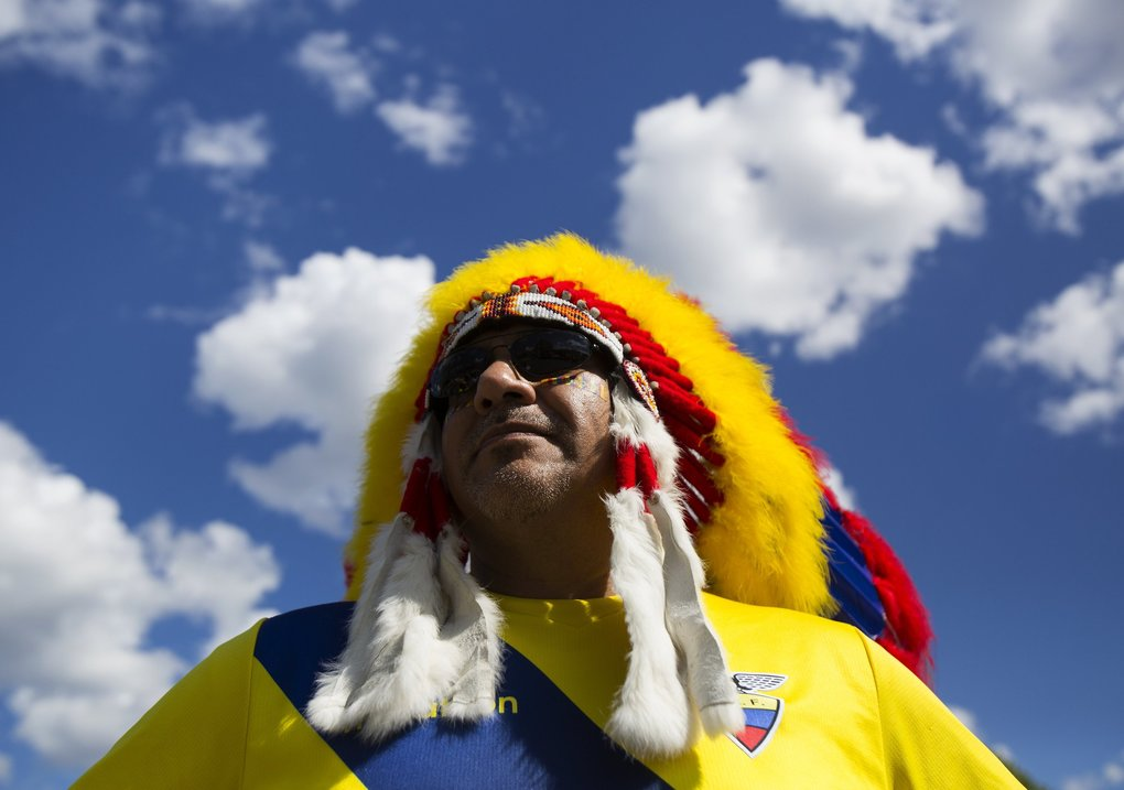 Los Angeles resident Marcos Rodriguez wears a headdress with the colors of the Ecuadorian fan before the Copa America match 25 quarterfinal between USA and Ecuador. (Sy Bean / The Seattle Times)