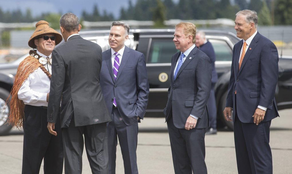 President Obama arrives at Sea-Tac on Friday afternoon on Air Force One. Obama is greeted by Gov. Jay Inslee, right,  Seattle Mayor Ed Murray, Mayor of Seattle, King County Executive Dow Constantine, and Brian Cladoosby, President, National Congress of American Indians at far left.   (Mike Siegel / The Seattle Times)