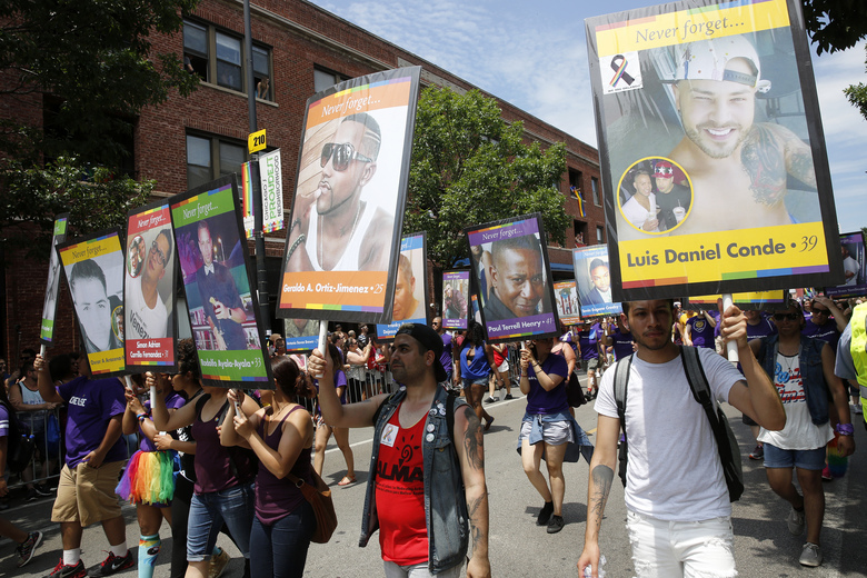 Portraits of the Orlando nightclub shooting victims are carried at the beginning of the 47th Annual Chicago Pride parade on Sunday, June 26, 2016 on Halsted Street in Chicago. (Michael Tercha/Chicago Tribune)