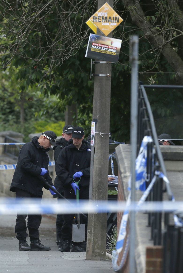 Police continue to search the crime scene in Birstall, West Yorkshire, England Friday, June 17, 2016 the day after Labour MP Jo Cox was murdered in the street outside her constituency advice surgery.  (Danny Lawson/PA via AP) UNITED KINGDOM OUT