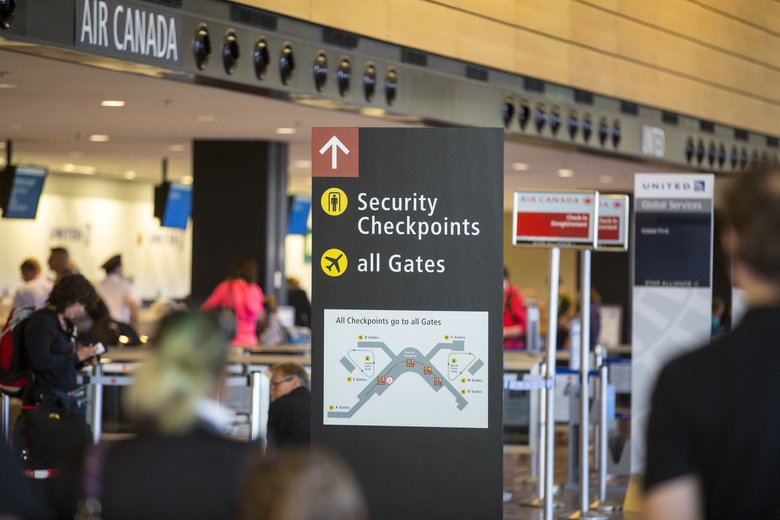 New improved signage at SeaTac. SeaTac Airport has various new and improved ways to move travelers more quickly and efficiently to get people through the TSA checkpoints. (Mike Siegel/The Seattle Times)
