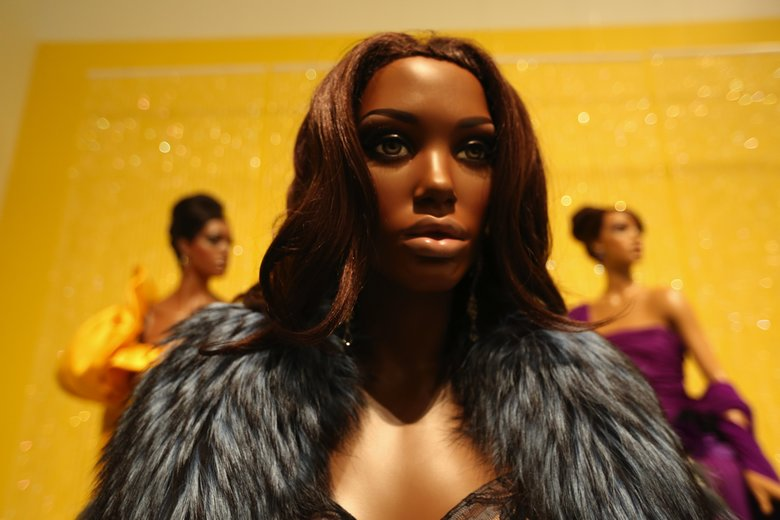 "A mannequin that resembles Tyra Banks wears an Angelo Marani ensemble of fox, rabbit, mink, synthetic lace and ribbon. The mannequins in ""Inspiring Beauty: 50 Years of Ebony Fashion Fair"" were made for the exhibit's premiere at the Chicago History Museum to resemble famous black models.  (Alan Berner/The Seattle Times)"