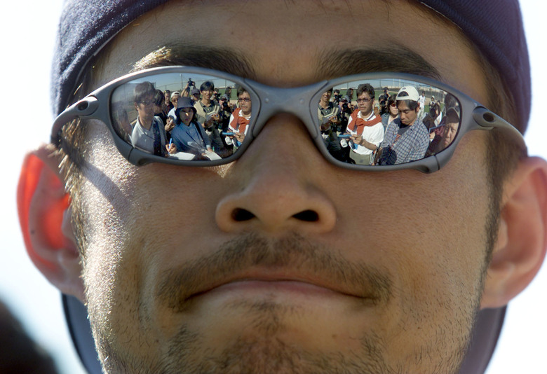 Everywhere he looks, Ichiro Suzuki is trailed by Japanese media that are chronicling his every move during Mariners spring training in 2001. (Dean Rutz/The Seattle Times)