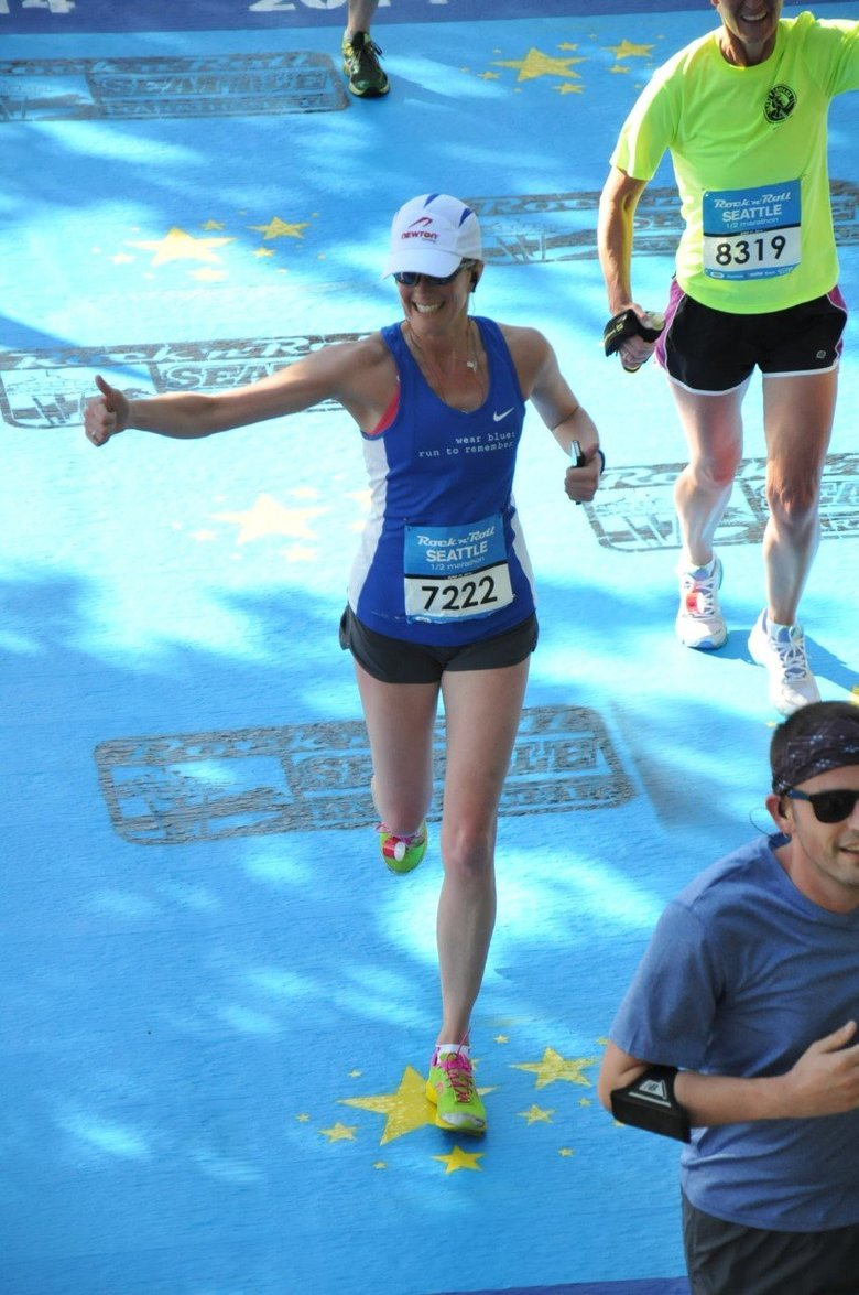 Former Seattle resident Gretchen Schoenstein, shown in the Seattle Rock 'n' Roll Half-Marathon in 2014, returns home to run in the same race Saturday despite a debilitating auto-immune disorder (MarathonFoto).