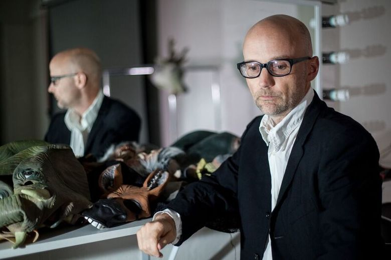 """Moby reads from his book 'Porcelain"""" at the Seattle Public Library Thursday, June 23. (Melissa Danis)"""