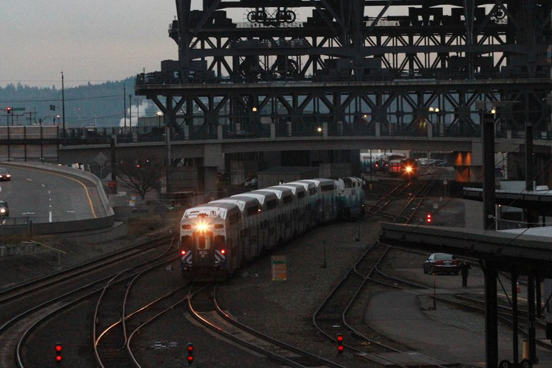 The Sounder train from Lakewood heads north to the platform. Safeco Field rises in the background above the BNSF tracks. (Alan Berner/The Seattle Times)