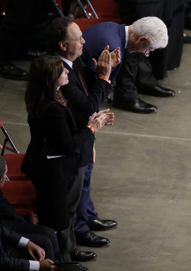 Former President Bill Clinton laughs while standing next to comedian Billy Crystal during Muhammad Ali's memorial service, Friday, June 10, 2016, in Louisville, Ky. (AP Photo/Darron Cummings)