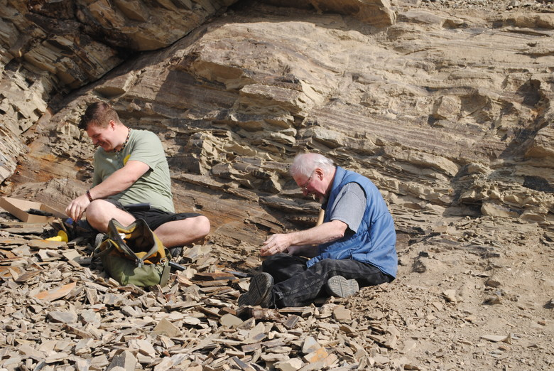 Karl Volkman (l) digs for fossils with his father, Don Volkman (r), at Stonerose Interpretive Center's fossil site in Republic, Ferry County.