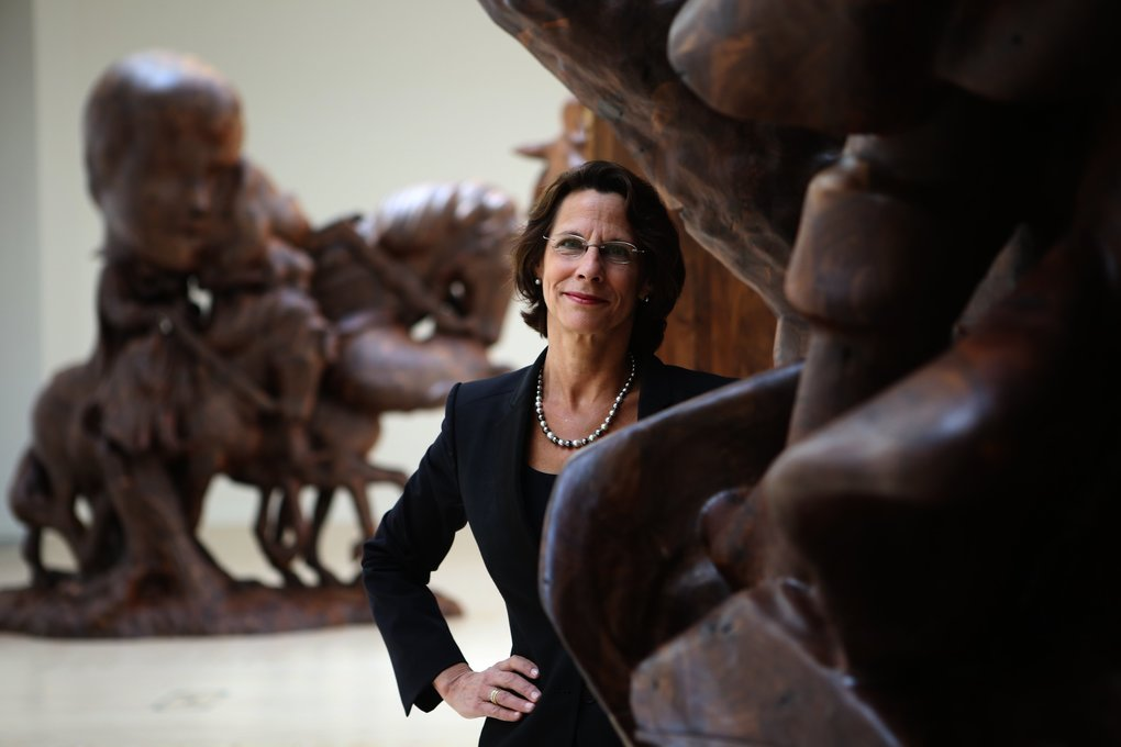 "Sylvia Wolf, who became the first female director of the Henry Art Gallery in 2008, shows off a current exhibition, ""Paul McCarthy: White Snow, Wood Sculptures.""  (Ken Lambert/The Seattle Times)"