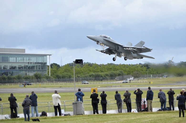 A Boeing F/A-18 takes off to perform during the Farnborough International Airshow in Great Britain last summer. (HANNAH MCKAY / EPA)