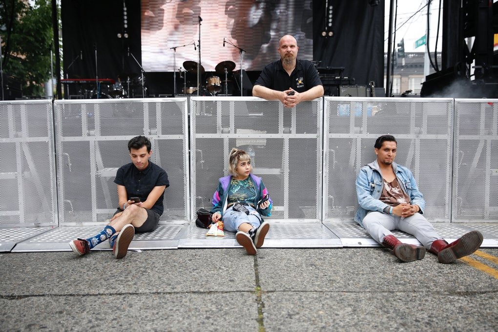 Left to right, Jacob Morales, Cass Bermudez-Lopez, and Jorge Herrera, arrive early at the Capitol Hill Block Party to secure a spot up front to see Crystal Castles perform.   (Sophia Nahli Allison / The Seattle Times)