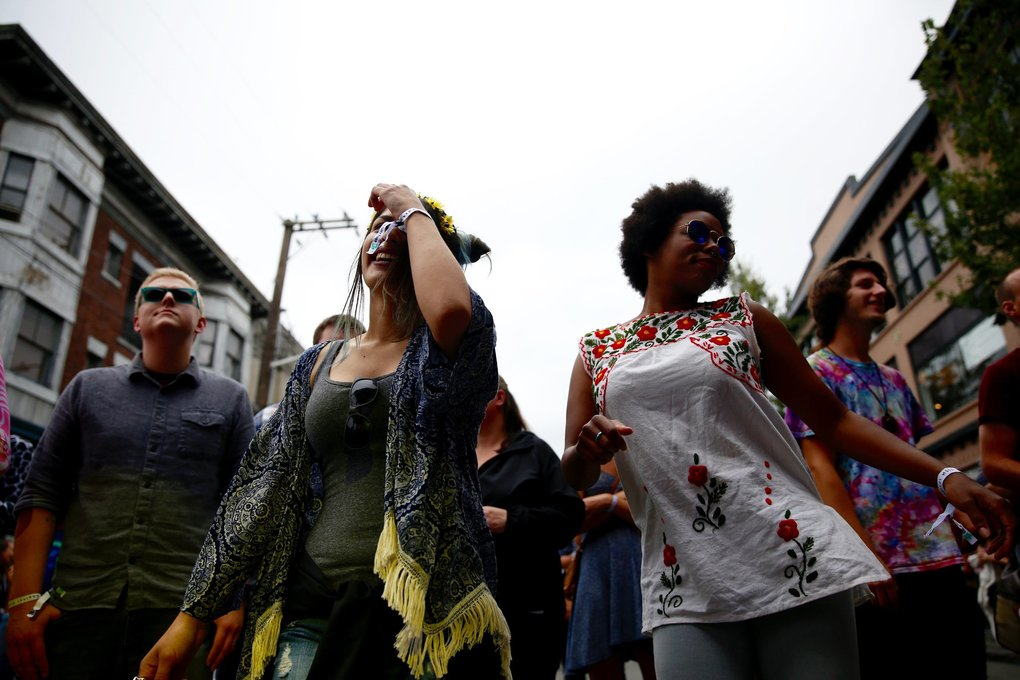 Yasmine Abdulrahimzi, left, and Nickia Delaware dance during The Dip's performance at the Capitol Hill Block Party on Friday. (Sophia Nahli Allison / The Seattle Times)