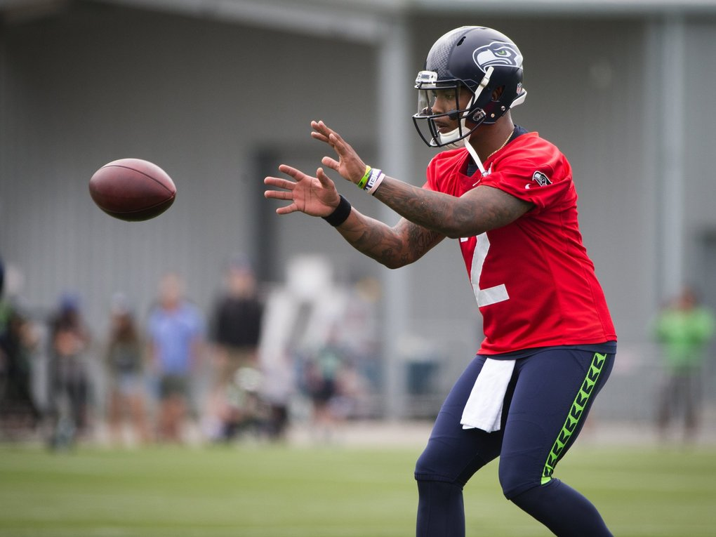 Seahawks rookie quarterback Trevone Boykin receives the ball during drills on the first day of Seahawks training camp.  (Lindsey Wasson / The Seattle Times)