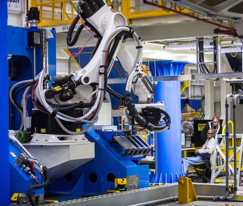 Boeing's South Carolina operation plays a growing role in engineering as well as manufacturing. Here, a robotic system drills holes and inserts bolts to assemble 787 aft fuselages. (Mic Smith / Special to the Seattle Times)