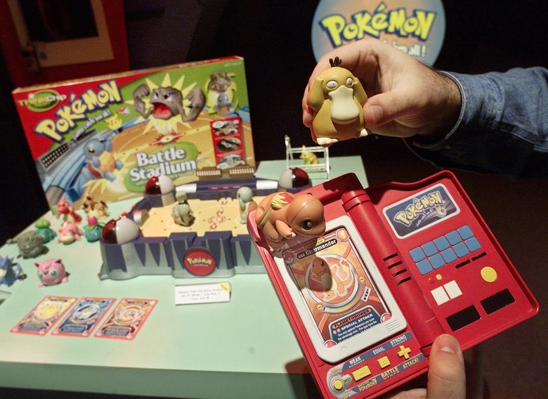 "FILE – In this Feb. 15, 2000, file photo, a Hasbro employee shows off components of the Pokemon Battle Stadium at the company's showroom in New York. A survey shows about 90 percent of adults who have downloaded the new ""Pokemon Go"" smartphone game in 2016, which lets you find cartoon monsters in the real world, are between 18 and 34-years-old, many who are old enough to have fallen in love with Pokemon the first time around. (AP Photo/Richard Drew, File)"