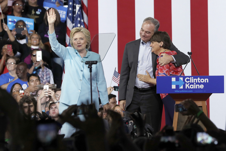 Sen. Tim Kaine, D-Va., hugs his wife Anne Holton during a with Democratic presidential candidate Hillary Clinton at Florida International University Panther Arena in Miami, Saturday, July 23, 2016. Clinton has chosen Kaine to be her running mate. (AP Photo/Mary Altaffer)