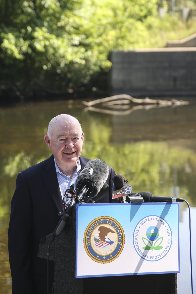 John Cruden, U.S. Department of Justice Assistant Attorney General for the Environment and Natural Resources Division, speaks at a news conference in Marshall, Mich., Wednesday, July 20, 2016 in Marshall, Mich. Enbridge Energy Partners has reached a $176 million settlement for the costliest inland oil spill in U.S. history — a pipeline rupture in southwestern Michigan that polluted a nearly 40-mile stretch of the Kalamazoo River, federal officials said Wednesday. (Chelsea Purgahn/Kalamazoo Gazette-MLive Media Group via AP)