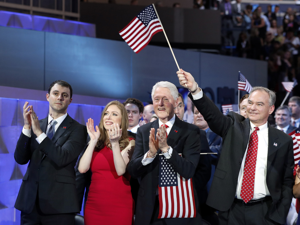 Marc Mezvinsky, his wife Chelsea Clinton, Former President Bill Clinton and Democratic vice presidential candidate, Sen. Tim Kaine, D-Va., applaud as Democratic presidential nominee Hillary Clinton speak during the final day of the Democratic National Convention in Philadelphia on Thursday. (AP Photo/Carolyn Kaster)
