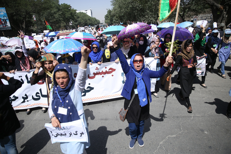 Thousands of demonstrators march towards the center of Kabul, Afghanistan, Saturday, July 23, 2016. Afghan authorities have closed off streets across the capital Kabul as they prepare for a demonstration by ethnic Hazaras demanding a planned power line be rerouted through their poverty-stricken province. (AP Photos/Massoud Hossaini)